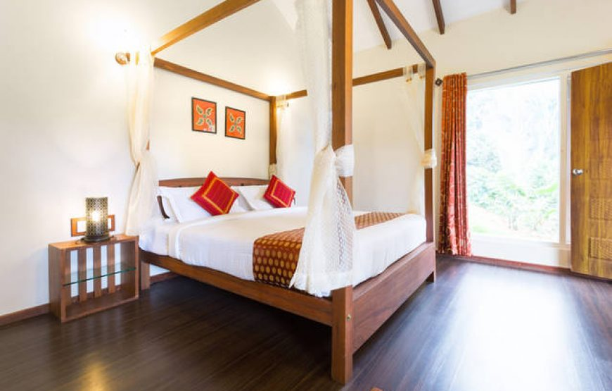 Wooden bed in homestay near munnar