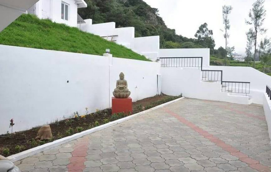 Buddha statue in the varanda of in ooty farm stay