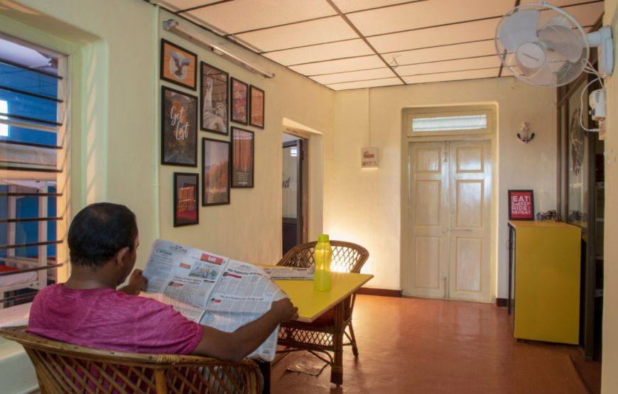 A visitor reading the newspaper in Decostel Coimbatore