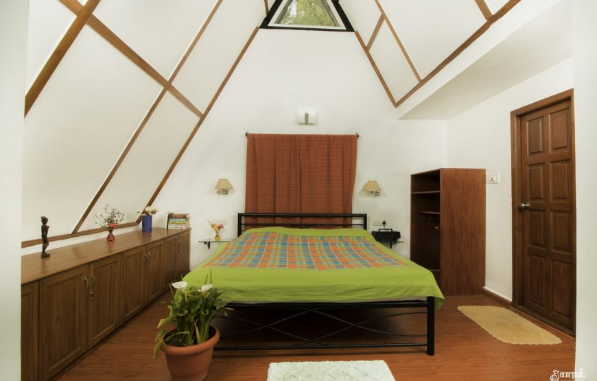 bedroom with well decorated interiors of tea estate stay in kotagiri