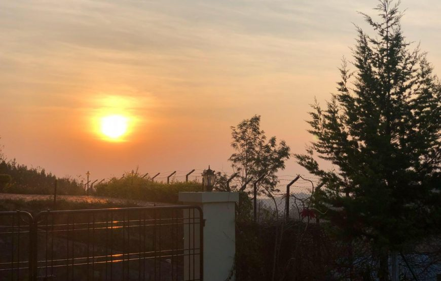 sunset view from serenity homestay kotagiri