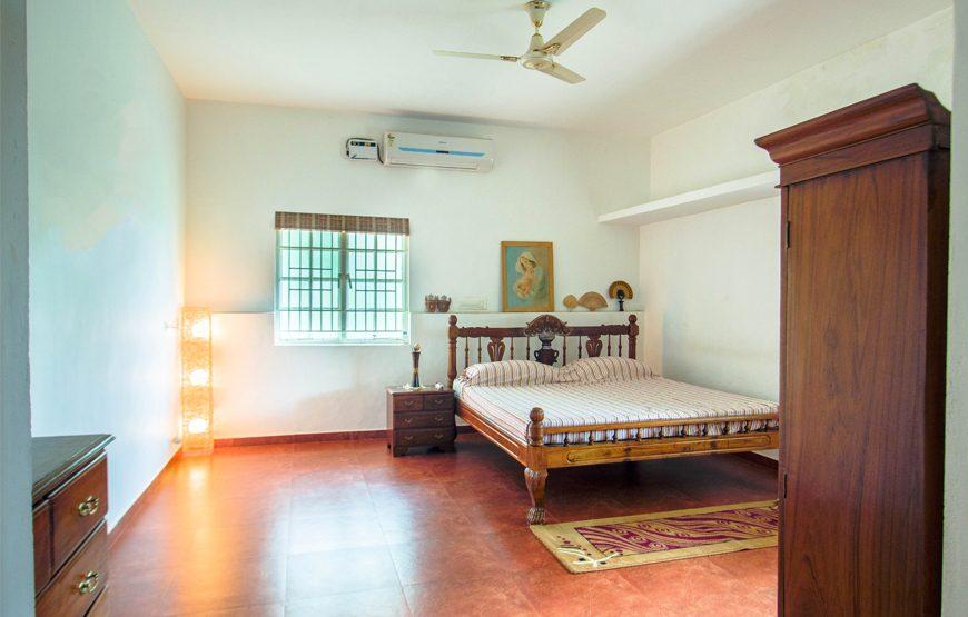 A luxurious bedroom of deco villa coimbatore