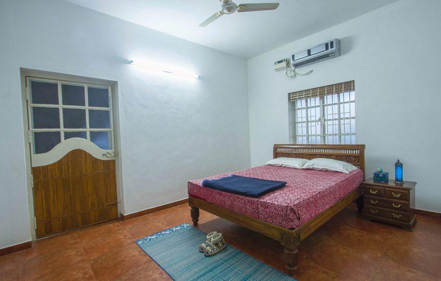 Air-conditioned bedroom of deco villa coimbatore