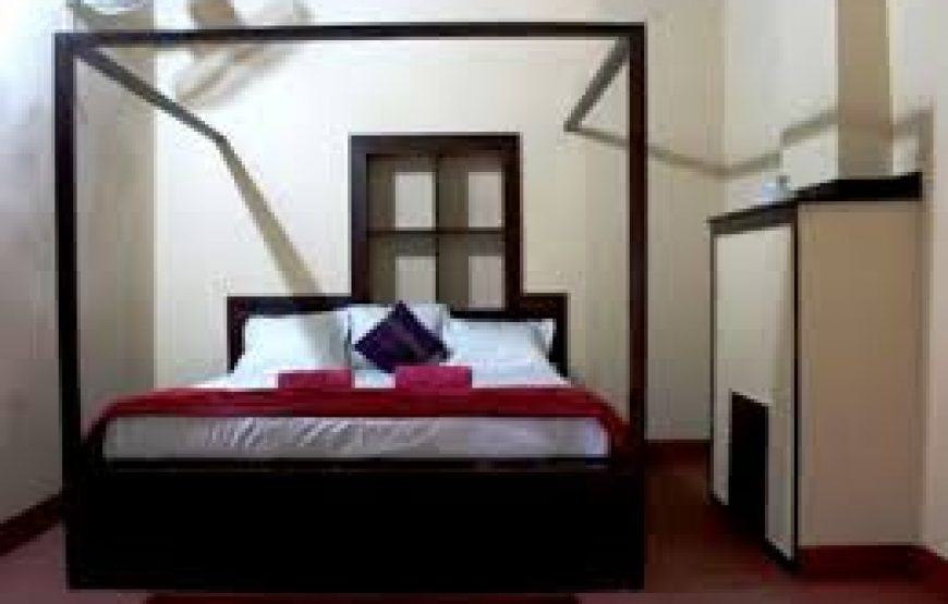 A well cushioned bed in coorg bungalow stay