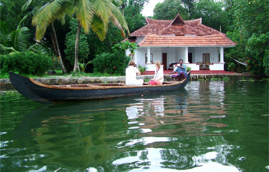 Foreigners and boatman in the rover boat of Alleppey Homestay Backwaters