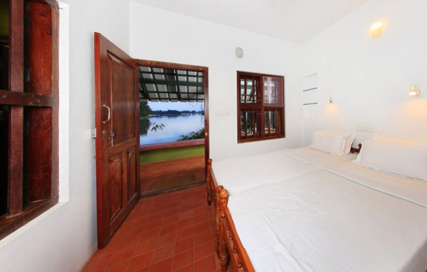 A well cushioned double beds of Alleppey Homestay Backwaters