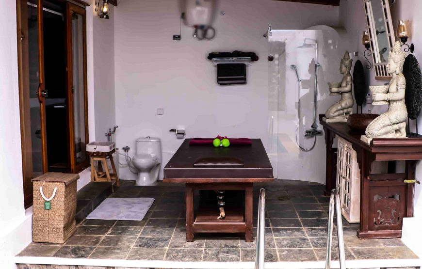 Bathroom with body massage table of homestay in anaikatti
