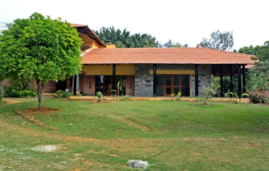 A Beautiful house , greenish trees & lawn in courtyard Bangalore