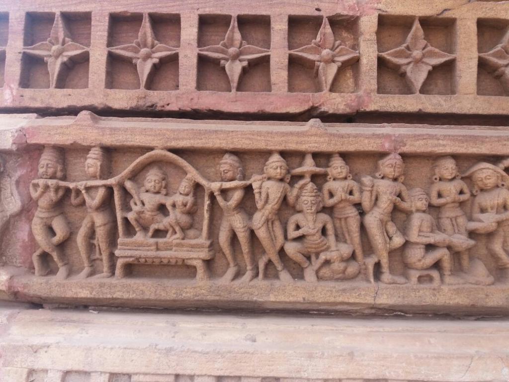 sand stone craving temple near aravali nature camp